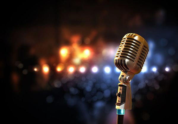 Stock photo of an old-fashioned microphone against a blurred background